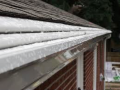 Waterfall Guards install under the shingle and clip to the front of your new gutter. Available in white and beige, they are made of durable vinyl.