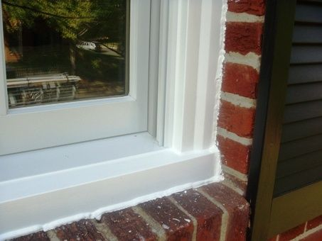 Replacement windows american windows siding of va inc for Exterior window trim for brick home