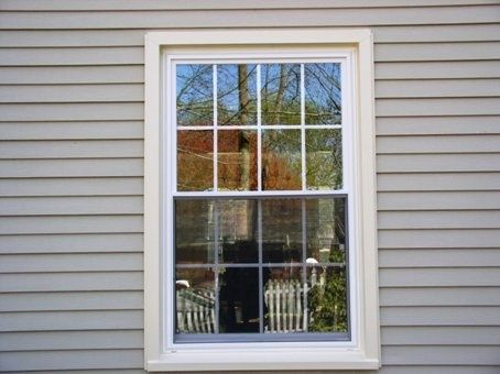 White Double Hung With Cream Cing In Siding