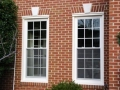 The existing sill, brick mold, and lintel are all clad with PVC coated aluminum.